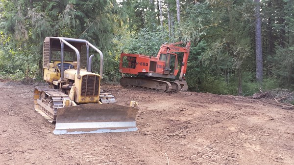 Bulldozers rest on the property of New Cottage in the Woods.