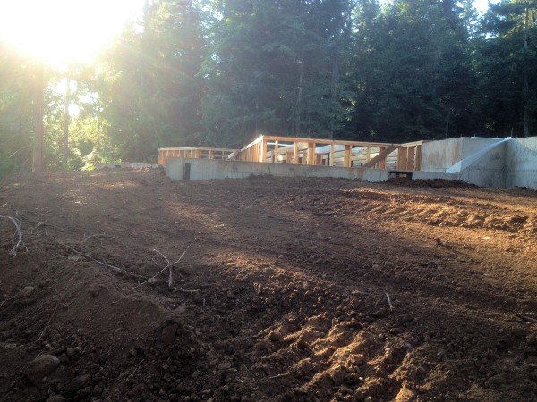 Landscaping below New Cottage in the Woods foundation.