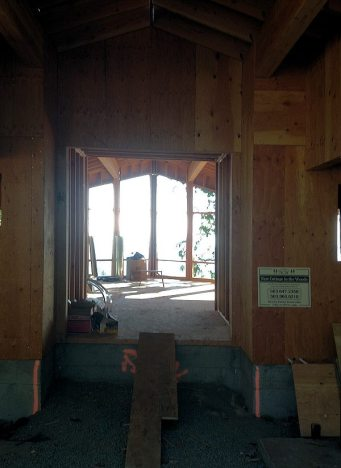 Cottage in the Woods - entrance of framed entryway to window