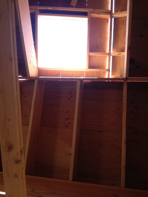 Cottage in the Woods - skylight over entrance in living room area.