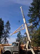 Crane lifts a truss up onto the roof of New Cottage in the Woords
