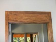Doors - wood trim details on top of door - New Cottage in the Woods with Rick Bernard