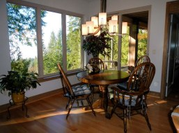 Dining Room with Dining Table and view out windows - New Cottage in the Woods with Rick Bernard