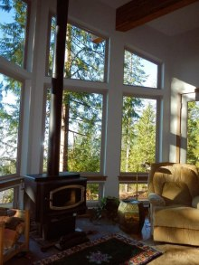 Living Room Wood Stove and View - New Cottage in the Woods with Rick Bernard