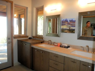 Master Bathroom - Sink and view to outside - New Cottage in the Woods with Rick Bernard